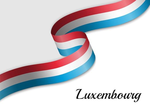 Macha wstążką flagi luksemburga