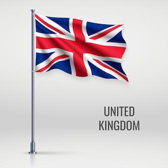 Machać flagą na masztem.