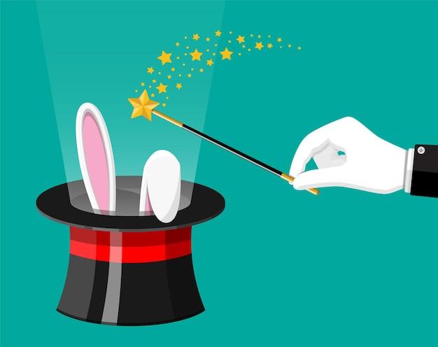 Magiczny kapelusz z uszami króliczka wielkanocnego i różdżką czarodzieja. iluzjonista kapelusz z królikiem i kijem.