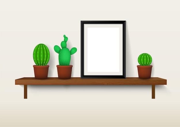Makieta czarnej drewnianej ramki na zdjęcia z różnymi rodzajami kaktusów i sukulentów na półkach. dekoracja wnętrz.