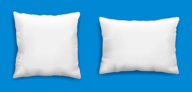 Makieta czystych białych poduszek na niebieskim tle ilustracji wektorowych w realistycznym stylu kwadratowa poduszka dla szablonu relaksu i snu