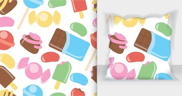 Makieta kwadratowej poduszki z wzorem cukierków, pączków, słodkich lodów i innych elementów.