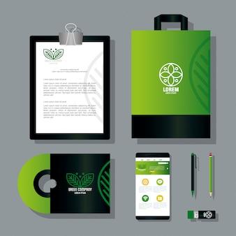 Makieta materiałów piśmiennych w kolorze zielonym z liśćmi znaku, zielonym identyfikacją wizualną
