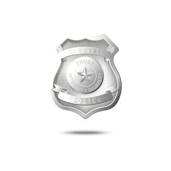 Makieta srebrnej odznaki policyjnej unoszącej się w powietrzu