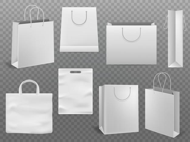 Makiety toreb na zakupy. pusta torebka białego papieru mody torba z rękojeścią 3d odizolowywał szablon