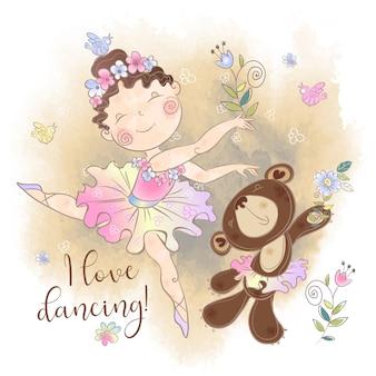 Mała baleriny dziewczyna tańczy z niedźwiedziem. kocham tańczyć.