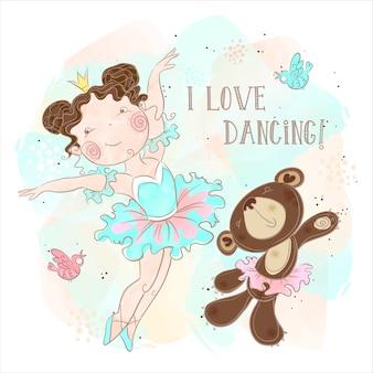 Mała baleriny dziewczyna tańczy z niedźwiedziem