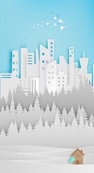 Mała drewniana papierowa sztuka papierowa z miastem i lasem
