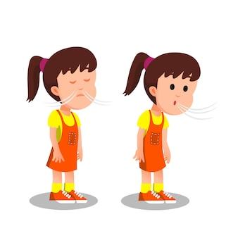 Mała dziewczynka bierze głęboki oddech, a potem robi wydech