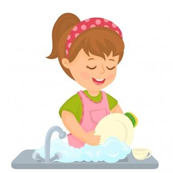 Mała dziewczynka myje naczynia