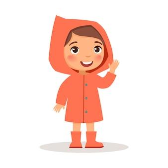 Mała dziewczynka stoi w koralowym płaszczu i gumowych butach.