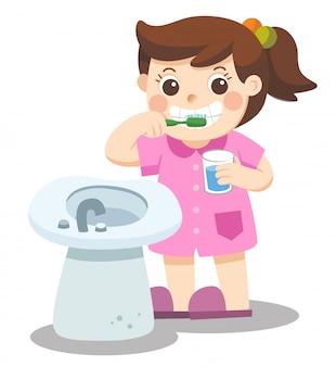 Mała dziewczynka szczęśliwa myć zęby rano.