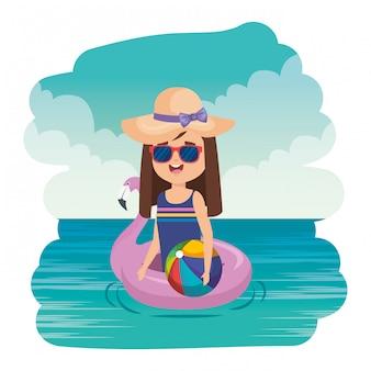 Mała dziewczynka z flemish pływaka i plaży balonem na morzu