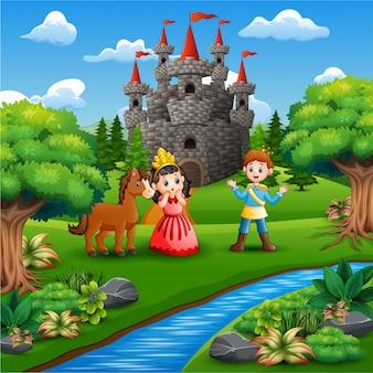 Mała księżniczka i książę w parku