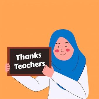 Mała muzułmańska dziewczynka trzymała znak z podziękowaniami dla nauczycieli