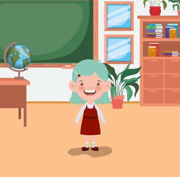 Mała studencka dziewczyna w sala lekcyjnej
