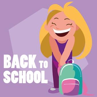 Mała studencka dziewczyna z szkolną torbą