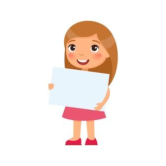 Mała uśmiechnięta dziewczyna trzyma pusty papier. słodkie uczennice z pustego arkusza papieru w rękach na białym tle.