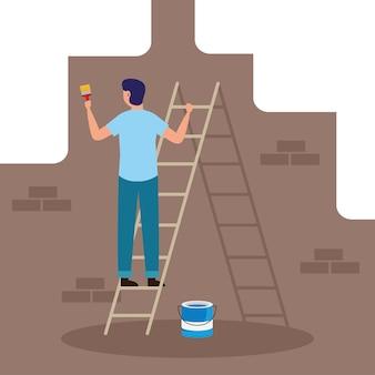 Malarz pędzlem i wiadrem maluje ścianę z cegły