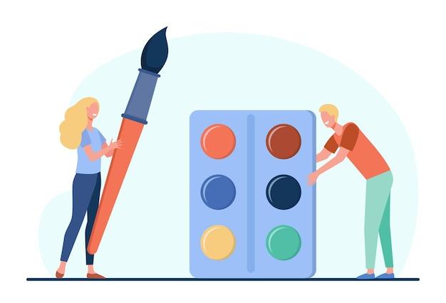 Malarze mężczyzna i kobieta trzymając pędzel i farby
