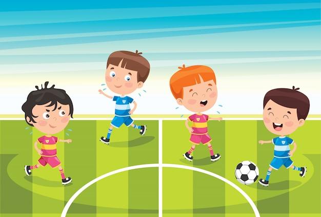 Małe dzieci bawiące się w piłkę nożną na zewnątrz