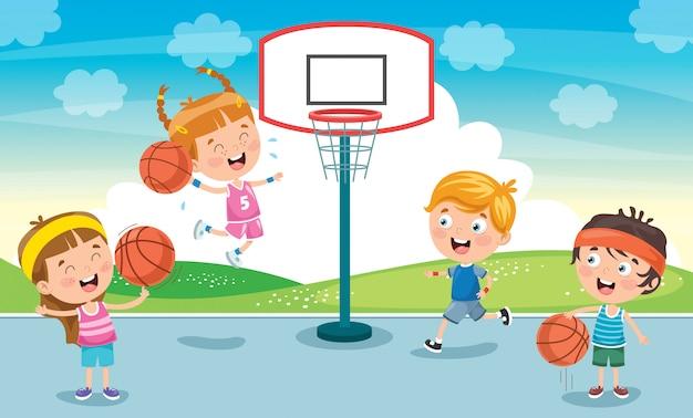 Małe dzieci grające w koszykówkę na zewnątrz