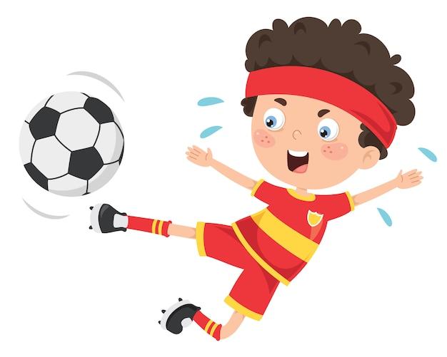 Małe dziecko gra w piłkę nożną na świeżym powietrzu