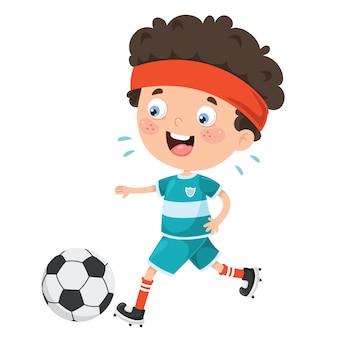 Małe dziecko gra w piłkę nożną na zewnątrz