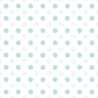 Małe zielone kropki w połowie kropli powtarzają się na białym tle wzór
