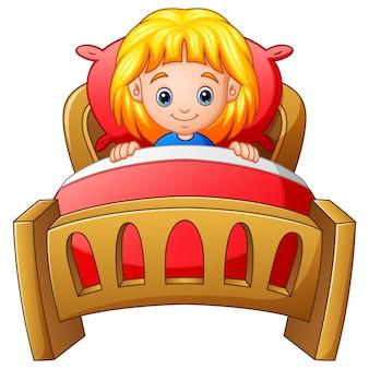 Małej dziewczynki dosypianie w łóżku