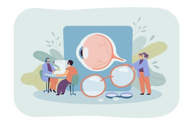Mali okuliści sprawdzający wzrok pacjenta na białym tle płaska ilustracja