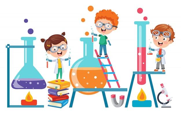 Mali studenci robią eksperyment chemiczny