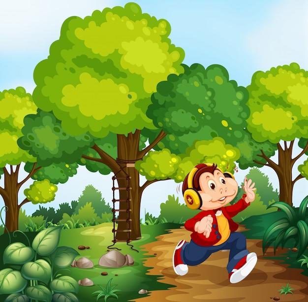 Małpia chłopiec w drewno scenie