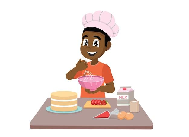 Mały afrykański chłopiec gotuje ciasto?