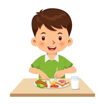 Mały chłopiec chętnie je śniadanie ilustracja wektorowa