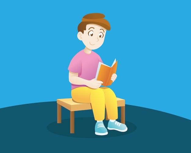 Mały chłopiec czyta książkę