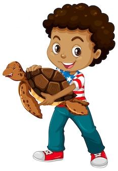 Mały chłopiec i żółw morski
