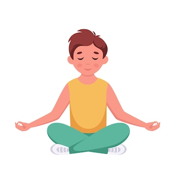 Mały chłopiec medytujący w pozycji lotosu gimnastyczna medytacja dla dzieci
