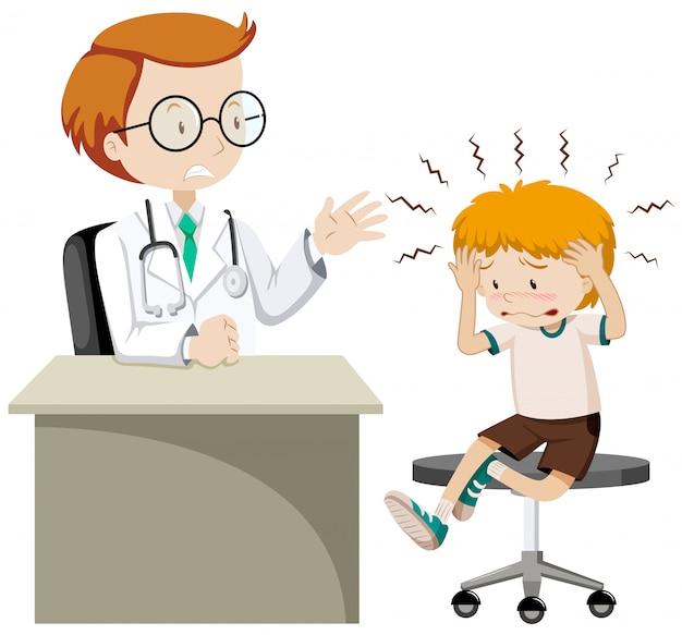 Mały chłopiec odwiedzając lekarza z bólem głowy