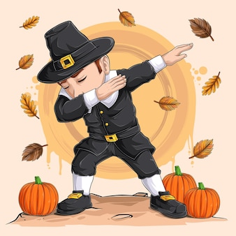 Mały chłopiec-pielgrzym tańczący taniec dabbingowy na święto dziękczynienia z okazji narodowego dnia dyni i święta żniw