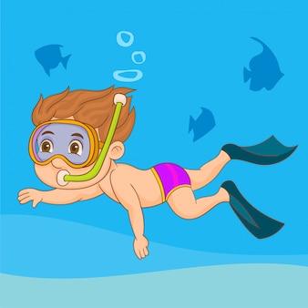 Mały chłopiec pływa w masce i płetw pod wodą z rybą