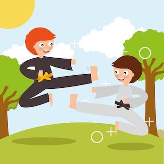 Mały chłopiec trenuje karate sztuki walki sport w krajobrazie