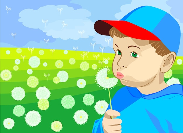 Mały chłopiec w niebieskiej czapce i niebieskiej kurtce, dmuchający latem na mniszka lekarskiego na zielonej łące