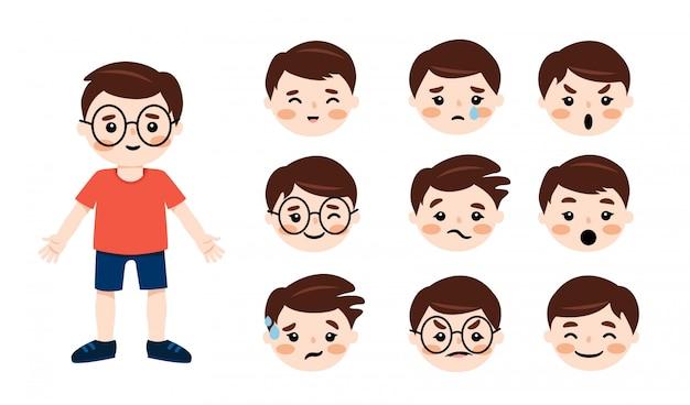 Mały chłopiec z brązowymi włosami ubrany w t-shirt, krótkie i snickers, twarze emocji