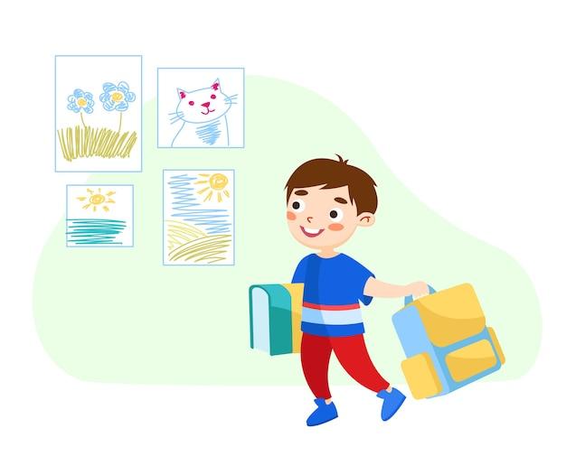 Mały chłopiec z książkami i plecakiem