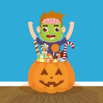 Mały chłopiec z przebraniem zombie i cukierki dyni