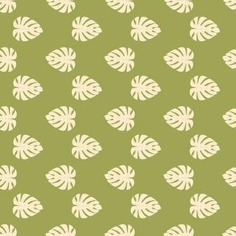 Mały jasnoróżowy monstera liść ornament wzór. egzotyczny ornament liści na zielonym tle.