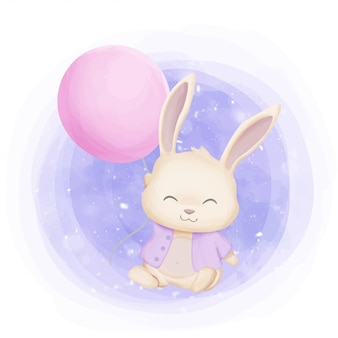 Mały króliczek bawi się balonem