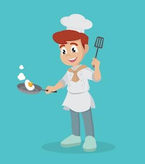 Mały kucharz z patelnią.