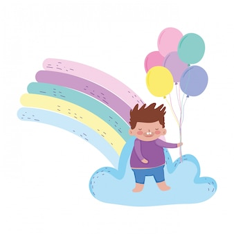 Mały pyzaty chłopiec z tęczy i balonów hel